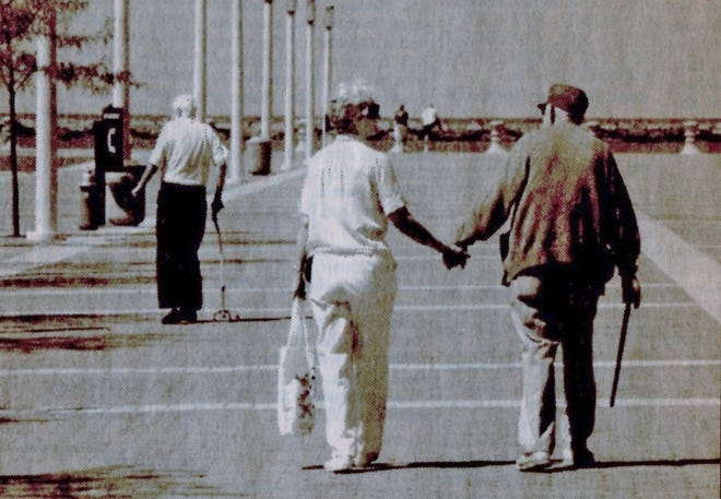 Dave MIkla's parents walk hand in hand on the pier at Lake Erie.