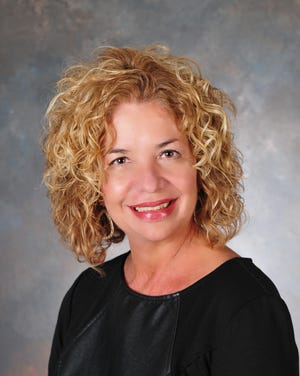 Glenda Lehman Ervin, vice president of marketing at Lehman's Hardware in Kidron, spoke to the Rotary Club of Loudonville on the business at the meeting April 1.
