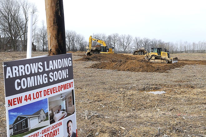 Earth was being moved Monday at the Arrows Landing housing development site off Mifflin Avenue in Ashland. Construction on the project of 44 single family homes will take place as weather allows.