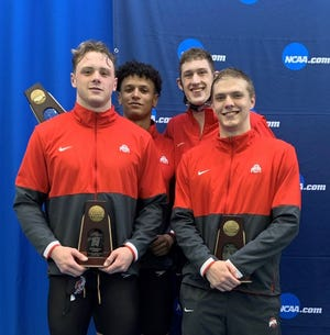 Ohio State swimmer Hudson McDaniel, front left, poses for a picture with the other members of the 200 medley relay team, which finished fourth at the Division I NCAA Swimming & Diving Championships on March 26.