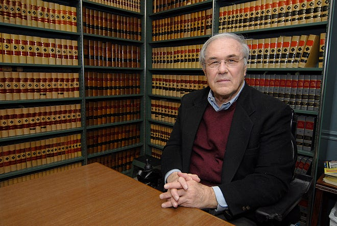 """Attorney O. Joseph """"Joe"""" Murray sits in the library in his office on West Main Street in this 2009 file photo."""