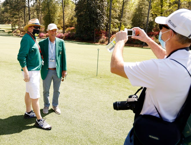 Dr. John McManus poses for a picture with Ben Crenshaw on no. 13 during Monday's practice round for the Masters at Augusta National Golf Club, Monday, April 5, 2021, in Augusta, Georgia. [ANDREW DAVIS TUCKER/THE AUGUSTA CHRONICLE]