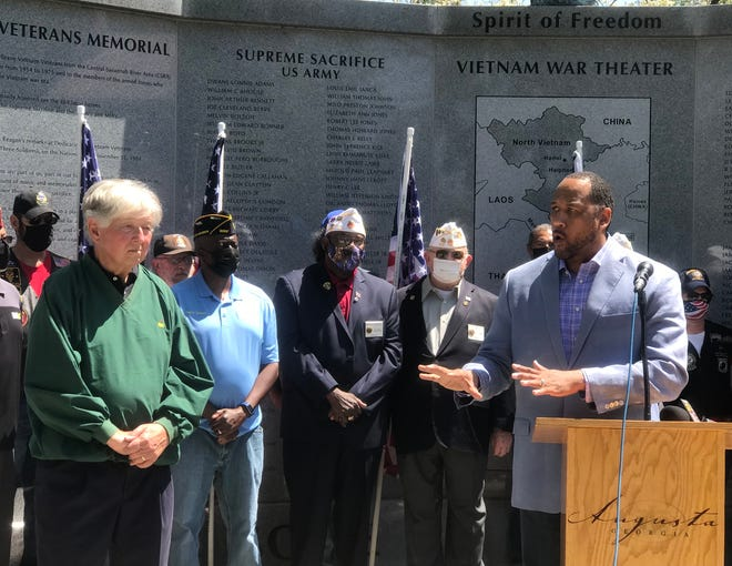 Former Augusta Mayor Bob Young (left) and former Forces United deputy director Don Clark speak about a proposed state veterans cemetery in Augusta at the city's Vietnam War Memorial.