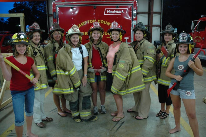 With this photo taken on July 29, 2008, The Guardian featured the Hampton Fire Department's ladies support unit, Hampton Emergency Auxiliary Team (HEAT).