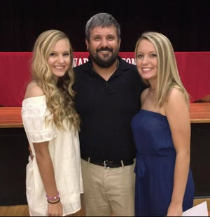 From left are Isabel Stanley, WHHS Coach Trey Stanley, and Emma Stanley. Since the Stanley girls were four years old, Coach Stanley has coached his daughters' soccer teams for a total of 16 years.