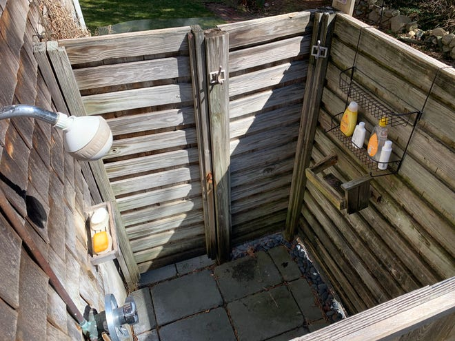 This Cape Cod outdoor shower is all dressed up and ready to go.