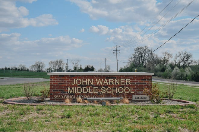 John Warner Middle School began in-person classes full time Monday. The new 126,431-square-foot middle school has a capacity for 700 to 750 students and cost $34 million to build.