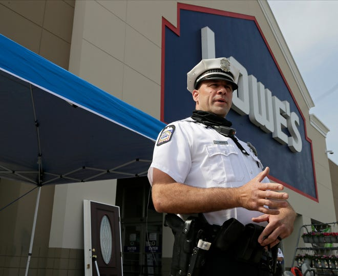 Columbus police officer Dan Snyder speaks at a Lowe's Home Improvement on Silver Drive Monday. Snyder identified home invasion as an issue after working with domestic violence victims. Lowe's and the Columbus Division of Police are working together to provide patrol officers with door security bars. Five hundred bars will be distributed into the community.