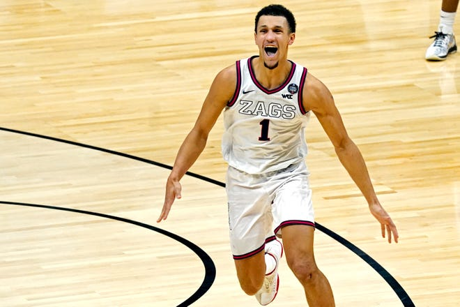 Gonzaga guard Jalen Suggs celebrates making the game-winning shot against UCLA on Saturday. Suggs was once the 15th-ranked dual-threat quarterback in the country.