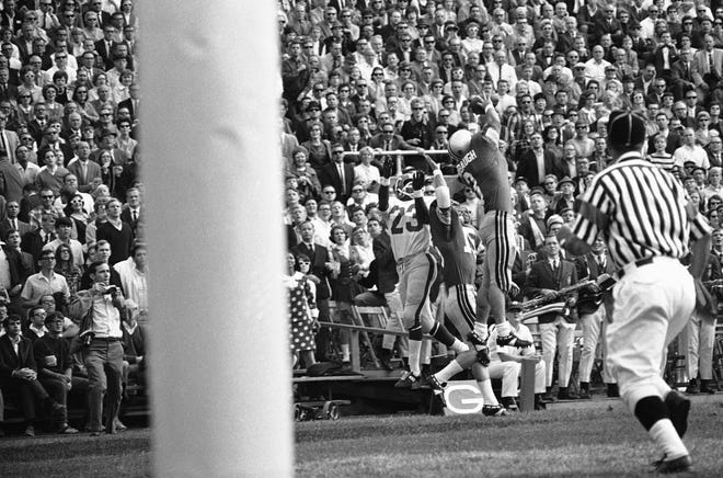 Ohio State safety Mike Sensibaugh (3) defends a pass against SMU on Sept. 28, 1968.