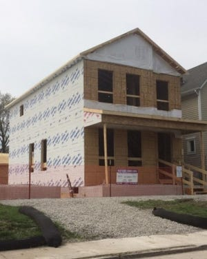 A house at 71 Hawkes Ave. in Franklinton is being built on Franklin County land bank property. A competition is being held for design of affordable homes costing no more than $170,000 that could be built on other land bank properties.