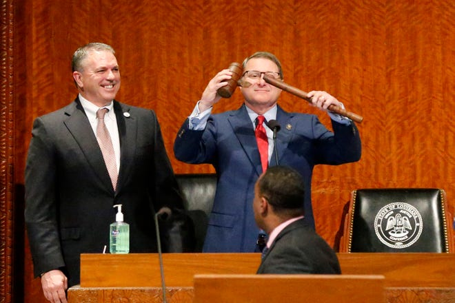 Louisiana House Speaker Clay Schexnayder, R-Gonzalez, left, and Senate President Page Cortez, R-Lafayette, react after Cortez broke Schexnayder's gavel for the opening of the 2020 general legislative session in Baton Rouge March 9, 2020. The 2021 session, which starts April 12, will take up how to spend $3.2 billion in federal stimulus money.