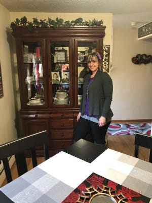 Dana Harris is shown in the apartment that Care & Share helped her move into two years ago.