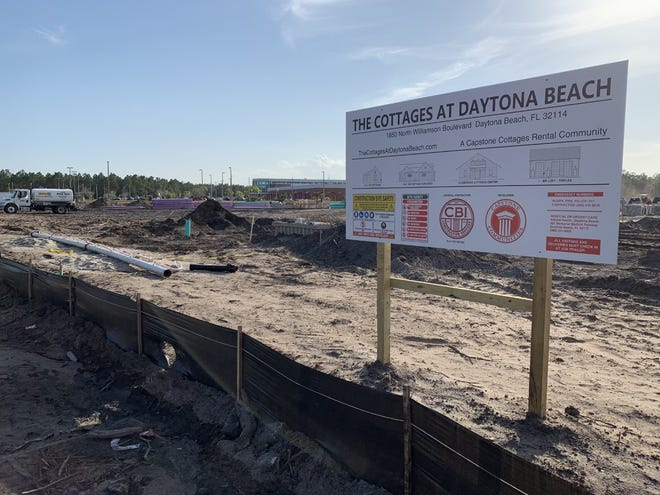 A sign along Williamson Boulevard in Daytona Beach, just north of the Advanced Technology College visible in the distance, notes that the site being cleared is the future home of a rental home community that will be called The Cottages at Daytona Beach.