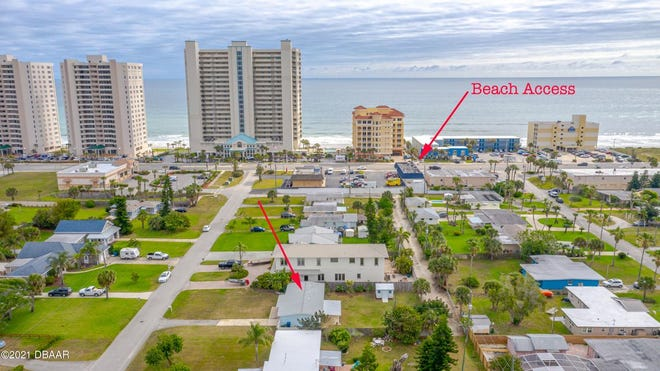 Nestled between the Atlantic Ocean and the Intracoastal Waterway on nearly a quarter of an acre, this freshly painted Daytona Beach Shores home is move-in-ready.