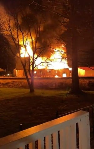 "A Kirkwood landmark known as the ""old mill"" was destroyed by fire over the weekend. The former Central Feed and Produce building was a complete loss in the fire that broke out late Saturday evening, according to Justin Taylor, chief of the Central Warren Fire Protection District in Kirkwood."