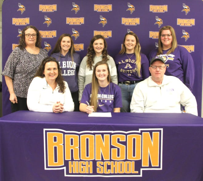 Bronson senior Meagan Lasky (center) was joined by her family and coaches as she signed her letter of intent to play volleyball at Albion College