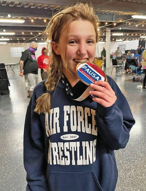 Western Wayne's Lexi DeSiato celebrates a fourth place finish at the 2021 My House Girls High School Wrestling Championships.