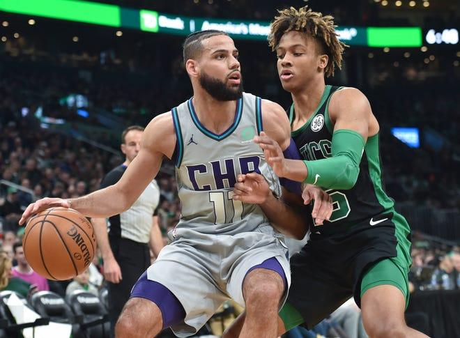 Dec 22, 2019; Boston, Massachusetts, USA;  Boston Celtics guard Romeo Langford (45) defends Charlotte Hornets forward Cody Martin (11) during the first half at TD Garden.