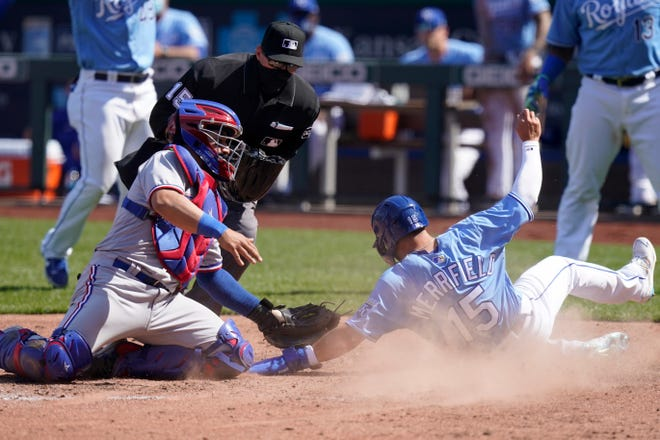 Kansas City Royals Whit Merrifield (15) beats the tag by Texas Rangers catcher Jose Trevino, left, during the sixth inning of Saturday's game at Kauffman Stadium. The Royals won 11-4 Saturday and lost 7-3 Sunday but won the series with Texas 2-1.