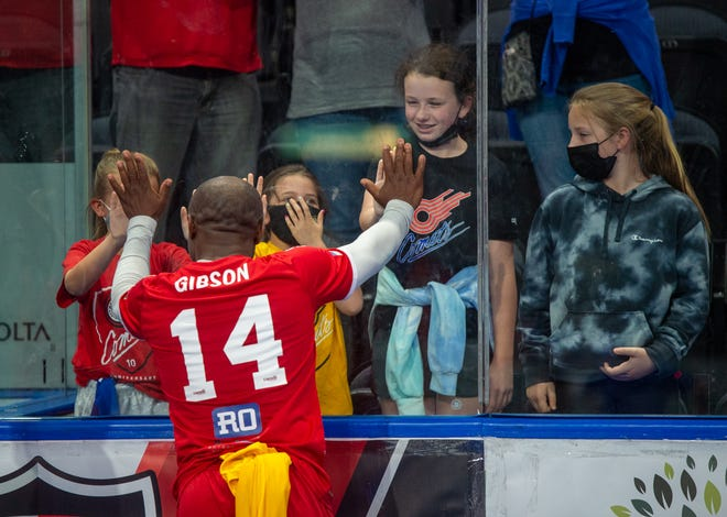 Kansas City Comets player/coach Leo Gibson (14) thanks young fans after their MASL semifinal playoff series loss last Saturday at Cable Dahmer Arena. The 38-year-old Gibson, the franchise's career leading scorer, said he will take time to consider whether or not he will return to the team next season.