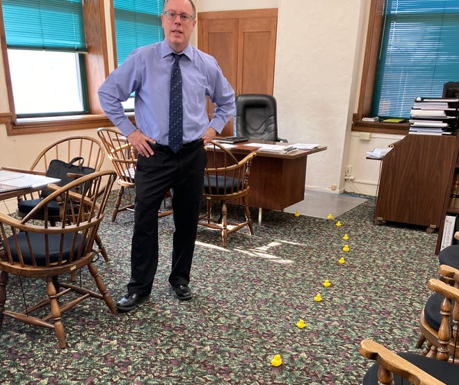 Burlington City Manager Chad Bird is greeted Monday by a line of rubber ducks leading from his office door to his new desk at City Hall. The ducks were frequently seen around Decorah and mailed to city clerk Kathleen Salisbury in anticipation of Bird's first day