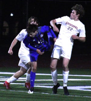 Episcopal midfielder Jack Adams (22) leaps to head the ball away from defense in a Region 1-3A boys soccer final against Bolles. Adams was named Monday to the Florida Dairy Farmers Academic All-State Team.