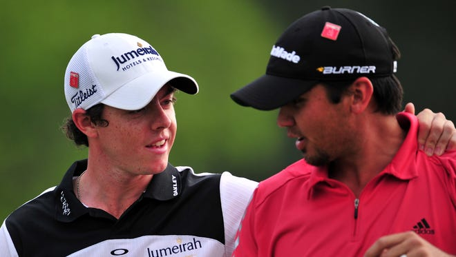 Jason Day (right) and Rory McIlroy played in the first two rounds of the 2011 Masters, along with Rickie Fowler.