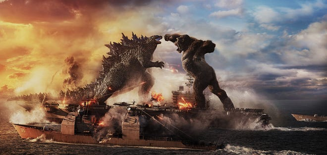"""The monster clash: Godzilla battles Kong in the action adventure """"Godzilla vs. Kong,"""" now in theaters."""