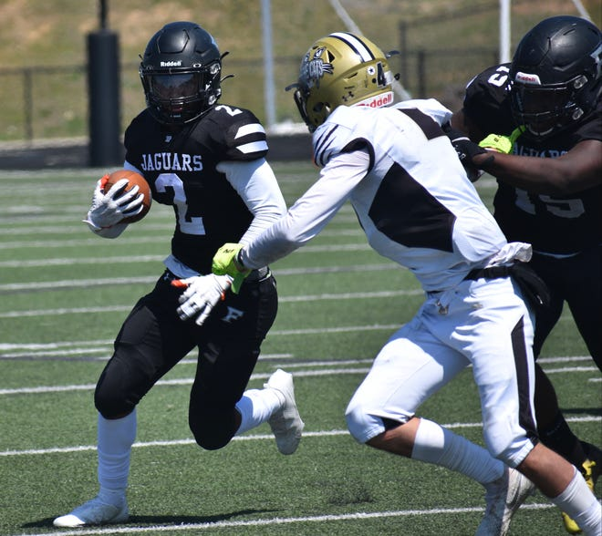 Forestview's Camury Reid looks to elude a North Gaston tackler during Monday's game at Stuart Cramer High School.