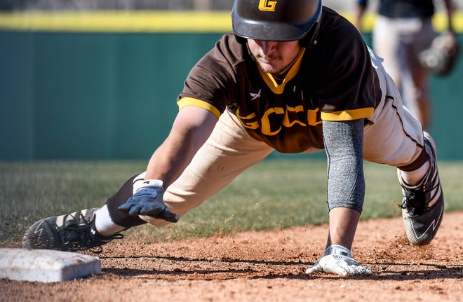Garden City Community College's Tyler Barth dives safely back to first base on a Pratt pick off play during a March game at Williams Stadium.