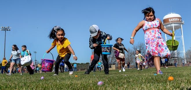 A group of five to seven-years-old children make their way through an outfield collecting platic Easter eggs filled with candy Saturday at Deane Wiley Park during the Garden City Recreation Commission's Easter egg hunt. Aproximately 400 youth participated in the event, where 7,000 plastic eggs were scatterred on four fields for the event.