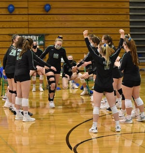 Senior Lily Wiese, who has not been able to play this season due to an ACL tear prior to the spring volleyball season, served the first point in Geneseo's recent win against Galesburg.