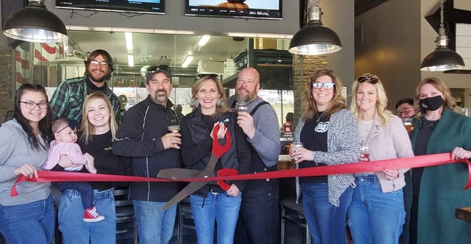 """The Geneseo Chamber of Commerce recently joined Great Revivalist Brew Lab (GRB) in celebrating GRB's Grand Opening Ribbon Cutting on Friday April 2, 2021. Pictured is GRB staff and representatives from the Geneseo Business Community who were on hand to welcome GRB to Geneseo. Due to the pandemic, GRB waited or over a year to celebrate their Grand Opening. Over the past year, GRB has not only adapted to the pandemic with new outdoor seating and greenhouses, but have also been a strong community partner in Geneseo. In noting the occasion, GRB Head Brewer Scott Lehnert proclaimed: """"It's great to be revived!"""""""