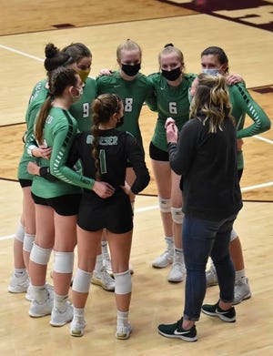 The Geneseo Girls Volleyball team with Coach Casey Komel at the Geneseo/Moline match held at Wharton Field House in Moline. Abbi and Maddi Barickman, Numbers 6 and 8, had stand-out performances in the contest.