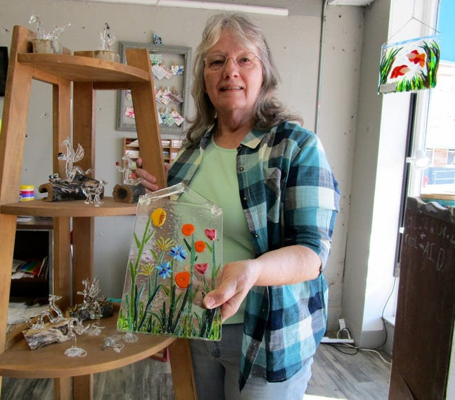 "Marie Skiles is shown with some of her ""hot glass"" art work on display at the Geneseo Art League, 125 North State St. Skiles will be among the area artists included in the 2021 Geneseo Artwalk planned for Saturday, April 17."