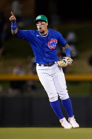 Chicago Cubs shortstop Javier Baez celebrates after catching San Diego Padres' Jurickson Profar stealing second base during the fourth inning of a spring training game Wednesday, March 17, 2021, in Mesa, Ariz.