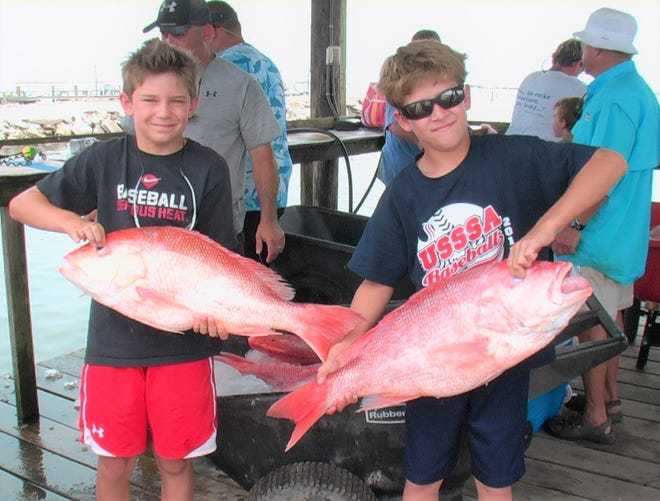 Hopefully we'll have many more photos like this with youngsters smiling after catching red snapper in the Gulf with the discovery of many more snapper.
