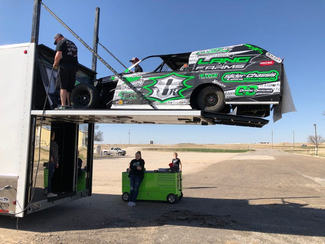 Driver Jesse Richter, Great Bend, uses a hydraulic elevator to unload his modified car on Saturday afternoon for opening day of the RPM Speedway at the Ellis County Fair Grounds.