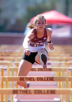 Bethel athlete Aubry Grame competes in the 100-meter hurdles at the Loren Ruesser Invitational.