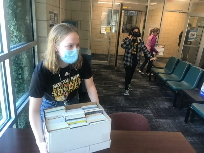 Elise Jantz and the Newton High School National Honor Society recently delivered about 200 books to the Harvey County Detention Center for the center library.