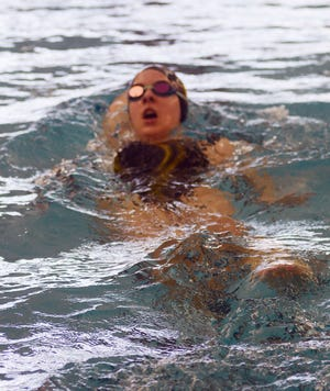 Newton swimmer Acacia Penner competes in the backstroke leg of the 200-yard medley relay at the Wichita Heights Invitational.