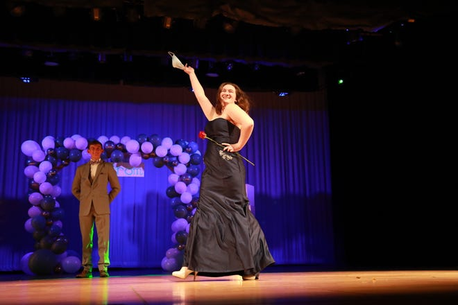 The Nordonia High School's Prom Fair's first model was Elizabeth Waight whose partner Spencer Will looks on.