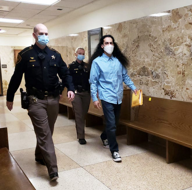 Phillip Velazquez is escorted out of the 364th District Court after a jury found him guilty of aggravated robbery in connection with the Jan. 27, 2017, armed robbery at Picantes Restaurant.
