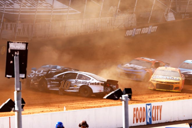 Driver Aric Almirola (10) collides with Anthony Alfredo (38) during a NASCAR Cup Series auto race, Monday, March 29, 2021, in Bristol, Tenn.