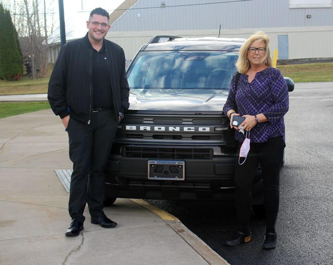 Henderson Ford sales consultant Nico Quarcini, left, and sales manager Beth DeCosmo showcase the 2021 Ford Bronco and other new vehicles at the Webster Chamber of Commerce's monthly breakfast at the Webster Recreation Center.