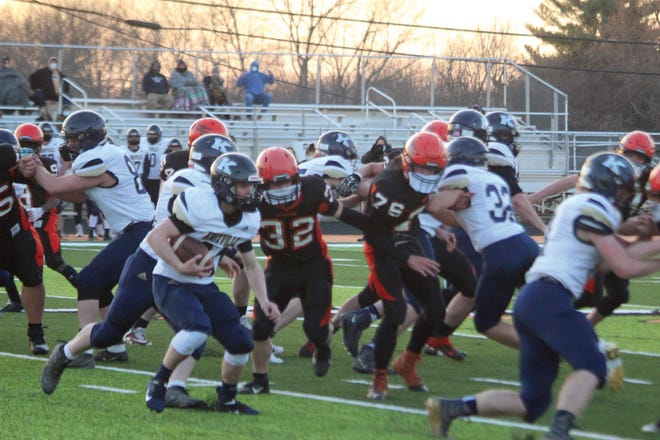 The Macomb defense tries to make a tackle during Friday's game against Knoxville.