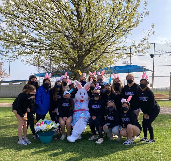 Members of the Midlothian High School softball team take time to hang out with the Easter bunny during the city's annual egg hunt on Saturday, March 27. The team helped lay out goodies across the four fields of the Midlothian Sports Complex.