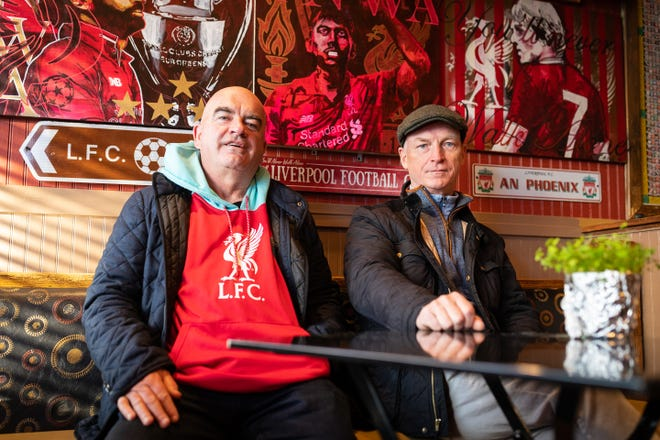 (L-R) Kevin Treanor and Joseph McCabe, co-owners of the Phoenix Landing in Central Square, sit inside the bar in Cambridge, March 29, 2021.