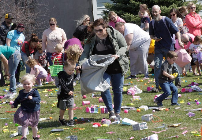 A group of 2-3 year olds and their families dash off within their designated pod area as they are among more than 2,000 children estimated to have participated in Saturday's Great Egg Hunt sponsored by Family Life Fellowship Church in Moberly.
